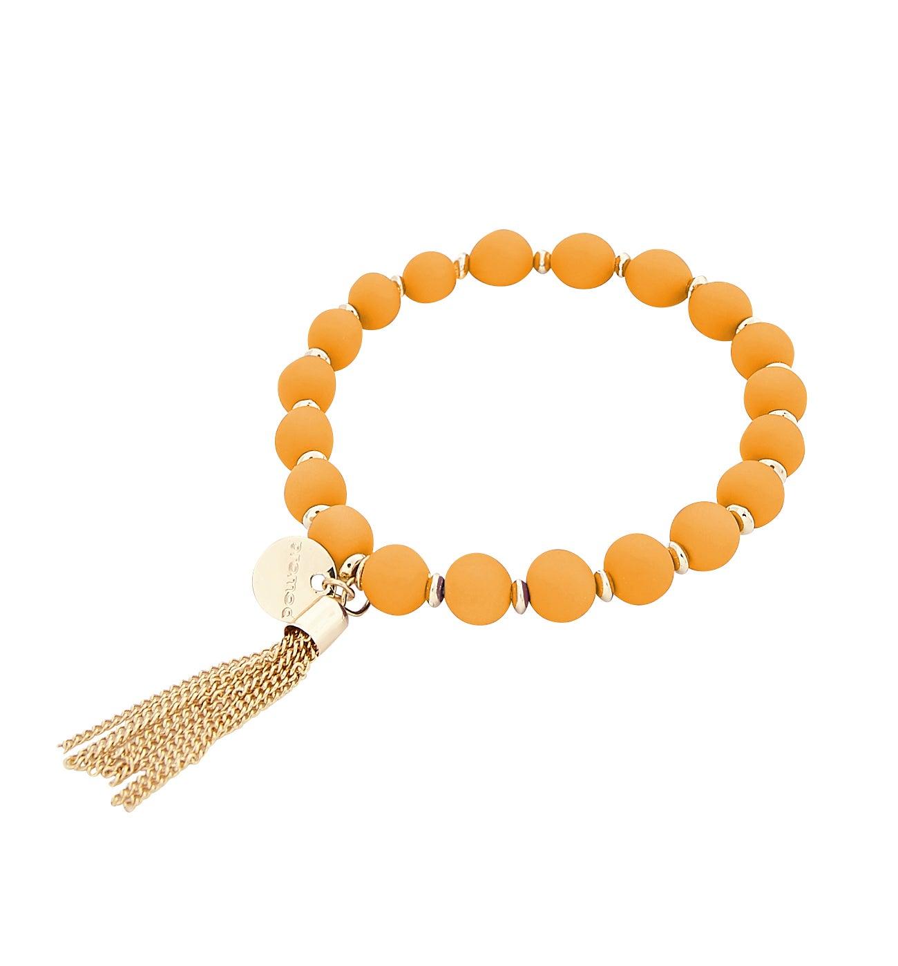 Bracelet en perle et pompon